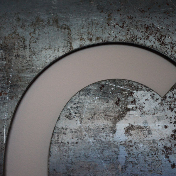 Closeup of steel cutout letter C