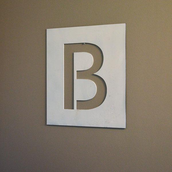 Steel cutout letter B on wall