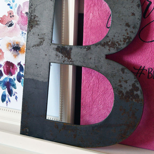 Steel letter B on shelf