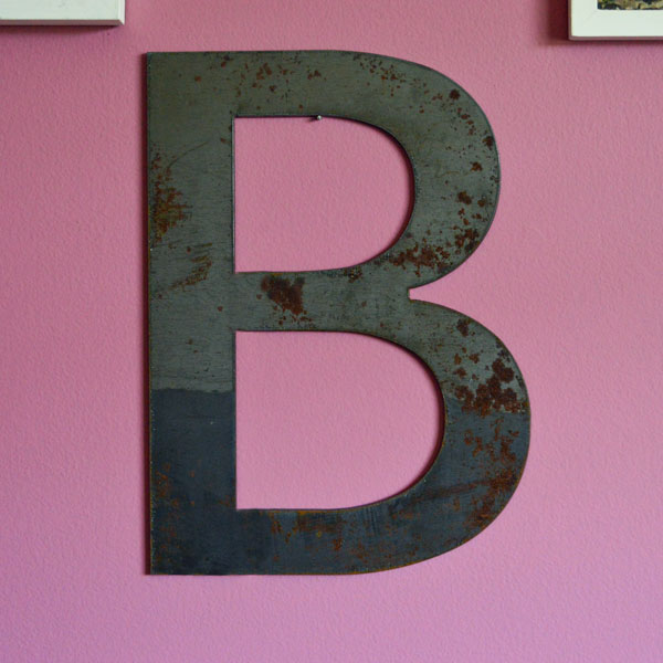 Steel letter B on wall